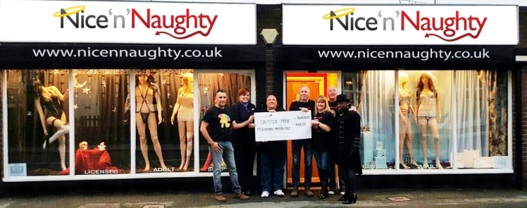 Nice 'n' Naughty Chester and The Golden Eagle staff with the cheque for £400